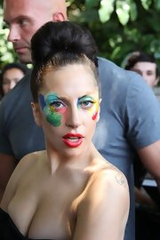 Lady Gaga kept her hair simple with a high bun so that her artistic makeup could take center stage.