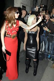 Lady Gaga finished off her fiery red cutout gown with a narrow black chain strap bag.