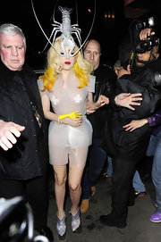 Lady Gaga paired her sheer ensemble with metallic ankle boots.