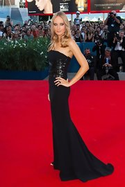 Olga looked like a supermodel in her leather-adorned black gown at the Venice Film Festival.