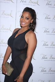 La La Anthony accessorized with a pair of massive dangling hoops during her birthday party.