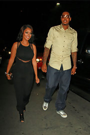 La La Anthony cut a voluptuous figure in a black lace-panel jumpsuit while out clubbing with her hubby.