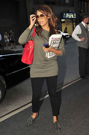 La La Anthony stepped out in New York City wearing black skinnies and a loose taupe sweater.