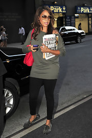 La La Anthony was comfily dress in a loose gray boatneck sweater and black skinnies while out and about in New York City.