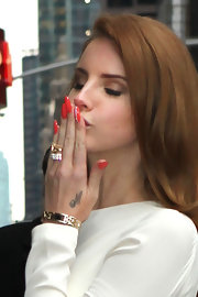 Lana Del Rey wore a vibrant cherry red polish on her ultra-long nails during an appearance on the 'Late Show With David Letterman.'