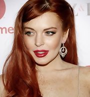 Lindsay Lohan gave her bright red locks a subtle touch of shimmer with a pair of dazzling dangle earrings.
