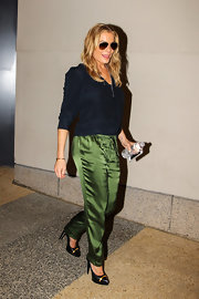 LeAnn sported deep green silk pants for a chic look while out in NYC.
