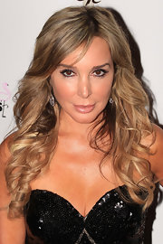 Marysol Patton opted for high-voltage glamour with tousled curls at the premiere party of 'The Real Housewives of Miami'.