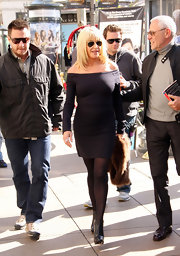 Suzanne accessorized with black leather ankle boots.