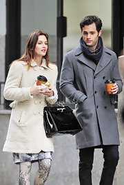 Leighton Meester was spotted on set where she showed off her patent leather tote bag, in classic black.