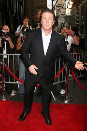 Alec Baldwin showed off his sleek side in a classic suit and white button down shirt.