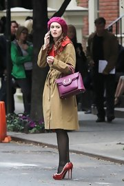 "Leighton Meester's structured plum purse was a polished accessory on the set of ""Gossip Girl."""