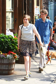 Lena wore a delicate-print flowing mini skirt on the set of 'Girls.'