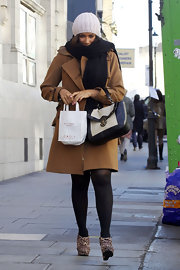 Leona Lewis fought the cold in a caramel trench and a thick black scarf.