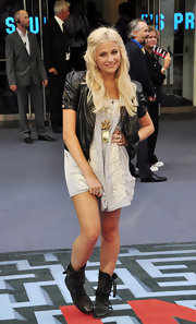 Pixie Lott paired her little dress with a leather jacket and combat boots.