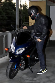 Leonardo DiCaprio suited up in a black motorcycle jacket after doing his Christmas shopping.