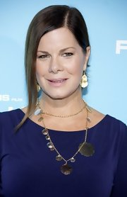 Marcia Gay Harden attended the Hollywood premiere of 'Flight' wearing a blue dress styled with gold jewelry including a gold lariat necklace.