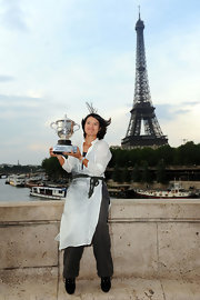 Li Na celebrated her French Open victory wearing a detailed white tunic.