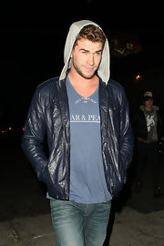 Liam shows his street style in a blue leather jacket with a hoodie.