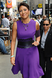 Robin Roberts' oversize black cutout belt added lots of style to her purple dress.