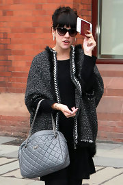Lily was spotted in London sporting a tweed Chanel jacket, which she paired with a quilted leather handbag.