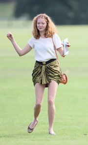 Lily Cole attended the Audi Polo Tournament wearing an exotic draped gold mini skirt.