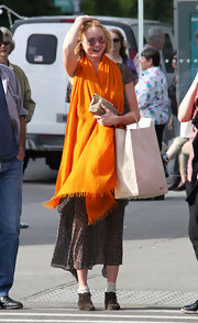 Lily Cole looked sunshiny on the streets of Soho with this bright orange scarf.