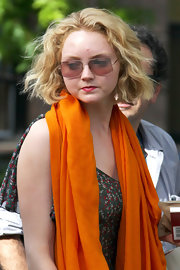 A pair of angular sunnies added a modern touch to Lily Cole's ensemble.