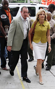 Michael Lohan's lawyer, Lisa Bloom wore a yellow button-down blazer and white skirt to the Beverly Hills Courthouse