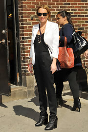 Lindsay Lohan kept her look very sleek and professional with this white blazer paired over a black top and black slacks.