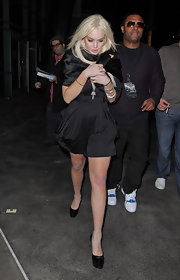 Lindsay Lohan looked chilly in her LBD while leaving the Jay-Z concert.