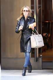Lisa Hochstein sported a black leather coat and matching belt while out in NYC.
