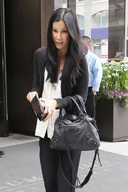 Lisa Ling had a leather black bag slung around her wrist as she strolled through the streets of Manhattan.