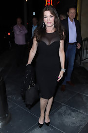 Lisa Vanderpump showed off her curves with this fitted black dress that featured a sheer neckline.