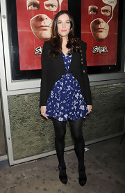 Liv Tyler looked girlish in a blue full dress with a white floral print.