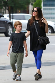 Liv Tyler wore a black tunic with white stars at the collar while out in NYC with her son.