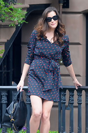 Liv Tyler has darling street style in a printed wrap dress while out in NYC.