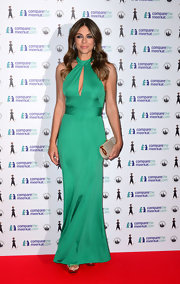 Elizabeth glistened in an emerald cutout halter gown that revealed just a touch of skin.