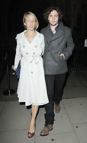 Aaron showed off a grey wool trench coat while hitting a party in London.