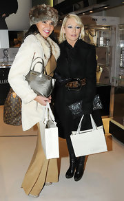 Lizzie had her hands full with three bags, most notably a large Louis Vuitton monogram purse slung over her shoulder.