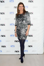 Amanda Lamb wore classic black patent pumps with purple-hued tights. The pairing offset a printed silk dress.