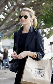 """The sophisticated Ms. Lo of """"The Hills"""" cast sports a simple loose ponytail her a trendy ensemble. Her highlights add dimension and she teased the top for a little volume."""