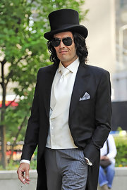 The actor was spotted on set wearing a tailcoat with a classic black top hat.