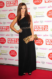 Maria Fowler finished off her glamorous ensemble with a gold gemstone-inlaid clutch for the News of the World Children's Champions Awards.