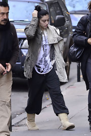 Lourdes Leon looked low key in a pair of tan mid-calf sheepskin boots.