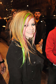 Avril Lavigne switched up her look with rainbow highlighted locks.