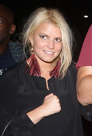 Jessica Simpson wore some long red, burgundy and purple feathered earrings while heading to see Adele in concert at the Greek Theater in Hollywood.