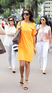 Lucy Mecklenburgh rocked a marigold hued shirtdress while out in Cannes.