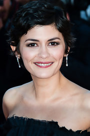 Audrey Tautou's short and choppy pixie kept her look flirty but edgy.