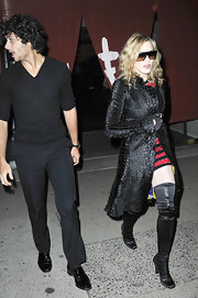 The material girl looked like someone out of the Matrix with a long black trench, oversized shades and skin tight over the knee boots. Sexy!